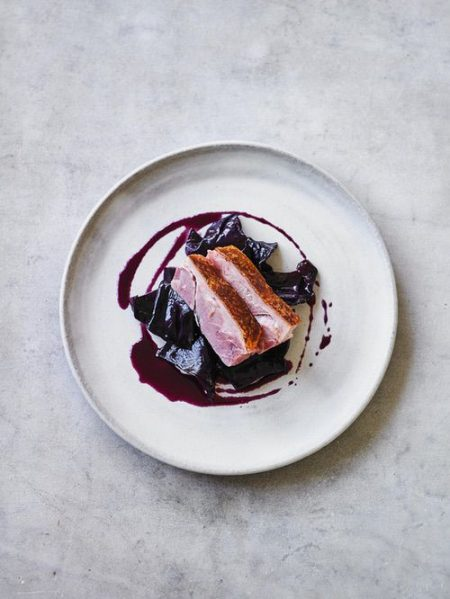 Pork knuckle with beer, juniper berries and caraway red cabbage